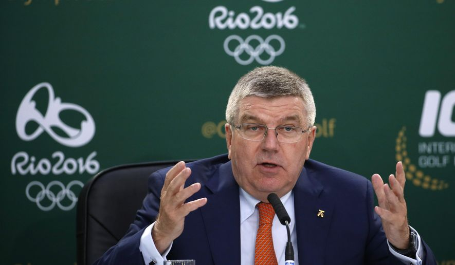International Olympic Committee president Thomas Bach speaks during a news conference during the second round of the British Open Golf Championship at the Old Course, St. Andrews, Scotland, Saturday, July 18, 2015. Golf will feature at the Rio 2016 Olympics. (AP Photo/Jon Super)