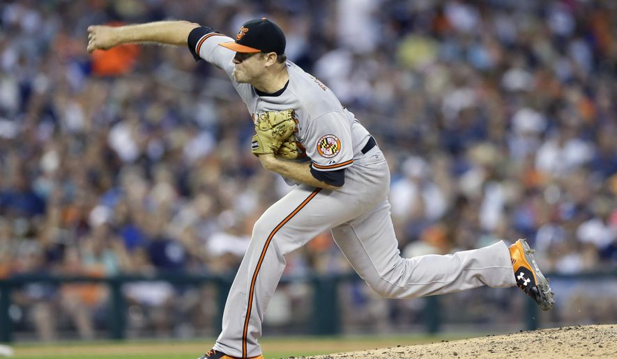 Baltimore Orioles starting pitcher Chris Tillman throws during the fifth inning of a baseball game against the Detroit Tigers, Saturday, July 18, 2015, in Detroit. (AP Photo/Carlos Osorio)