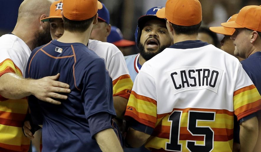Texas Rangers' Prince Fielder, center, confronts Houston Astros' Jed Lowry, in navy blue, after both benches cleared in the ninth inning of a baseball game Saturday, July 18, 2015, in Houston. The confrontation took place after Astros catcher Hank Conger and Rangers' Rougned Odor exchanged words. (AP Photo/Pat Sullivan)