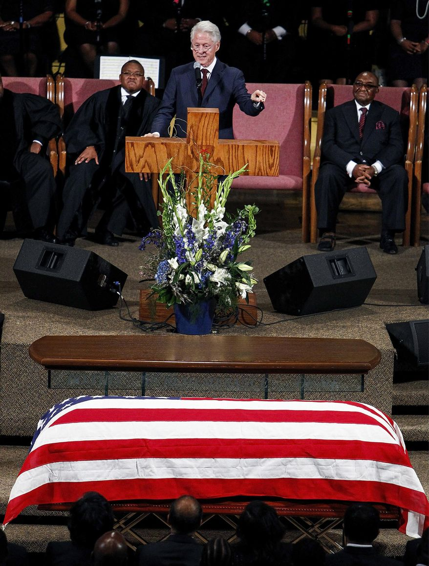 Former President Bill Clinton gives a eulogy during the funeral for Judge D'Army Bailey at the Mississippi Boulevard Christian Church, Saturday, July 18, 2015 in Memphis, Tenn. Bailey helped preserve the Memphis hotel where civil rights leader Martin Luther King Jr. was assassinated and turn it into the National Civil Rights Museum. (Mark Weber/The Commercial Appeal via AP) MANDATORY CREDIT
