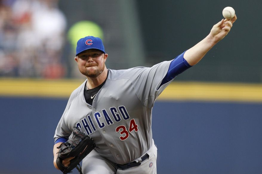 Chicago Cubs starting pitcher Jon Lester (34) throws in the first inning of a baseball game against the Atlanta Braves, Saturday, July 18, 2015, in Atlanta. (AP Photo/Brett Davis)