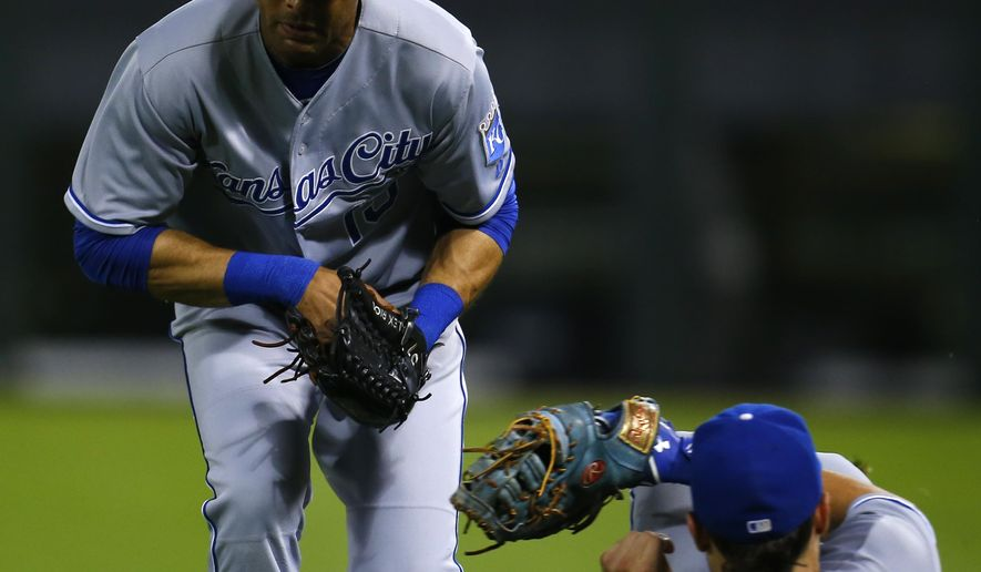 Kansas City Royals right fielder Alex Rios, left, and first baseman Eric Hosmer (35) collide and drop the baseball during the seventh inning of a baseball game against the Chicago White Sox in Chicago, Friday, July 17, 2015. (AP Photo/Jeff Haynes)