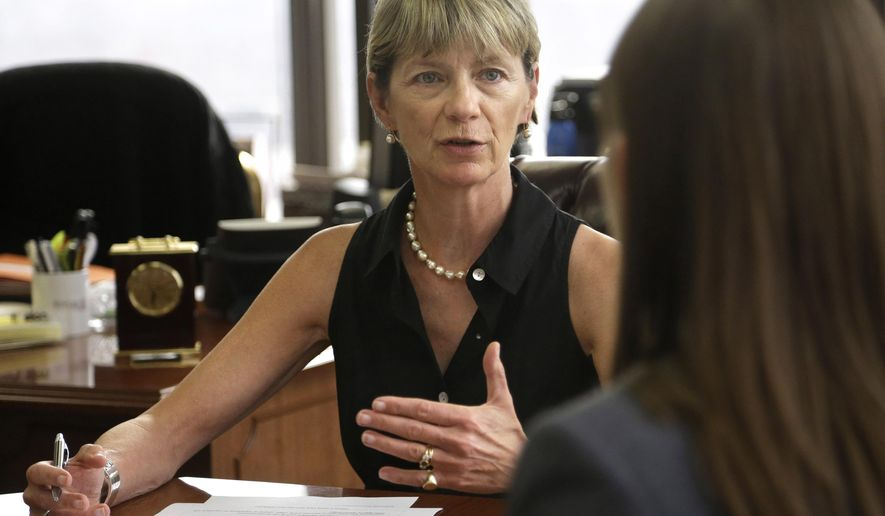 FILE - In this Monday, July 13, 2015 file photo, Massachusetts Secretary of Health and Human Services Marylou Sudders, left, speaks during a meeting in her office in Boston. In an interview with The Associated Press, Sudders said she is reviewing the way the state treats those with serious mental illnesses and debilitating substance abuse problems who get caught in the criminal justice system.  (AP Photo/Steven Senne, File)