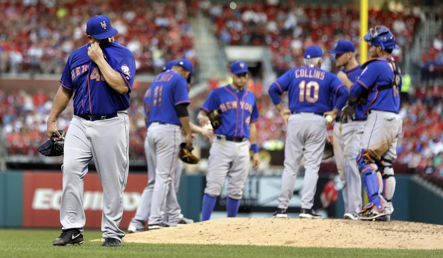 New York Mets starting pitcher Bartolo Colon, left, leaves the field after being removed from a baseball game during the fifth inning against the St. Louis Cardinals Saturday, July 18, 2015, in St. Louis. (AP Photo/Jeff Roberson)