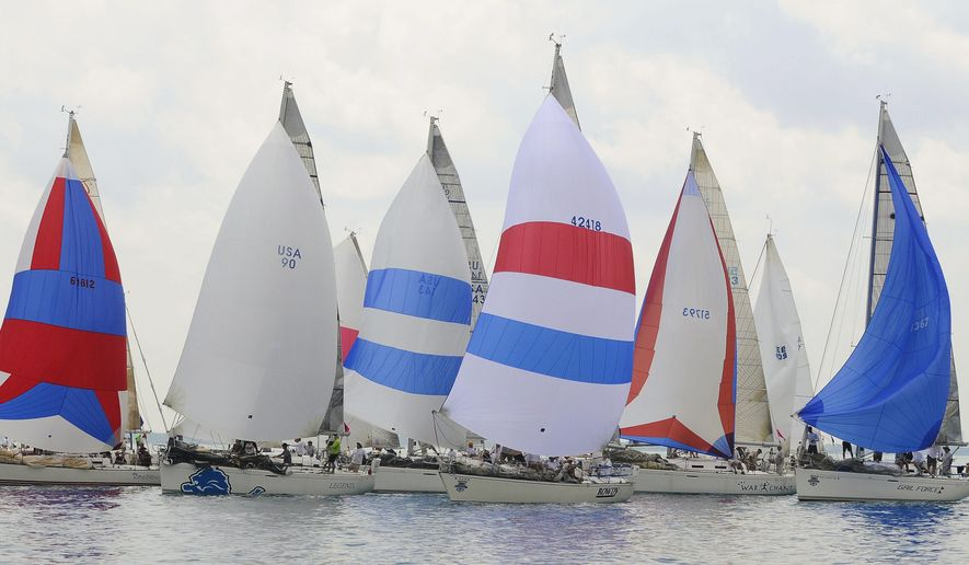 The Class H Division boats sail grouped together up the lake Saturday, July 18, 2015, during the start of the Port Huron-to-Mackinac Island Sailboat Race at Port Huron, Mich. (Mark R. Rummel/The Times Herald via AP)