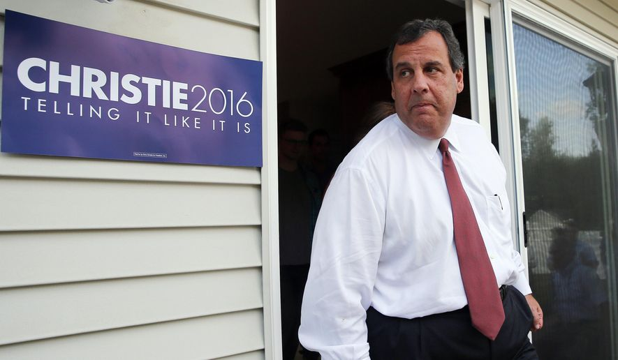 Republican presidential candidate New Jersey Gov. Chris Christie arrives in the backyard at a house party in Salem, N.H., in this July 17, 2015, file photo. (AP Photo/Winslow Townson)