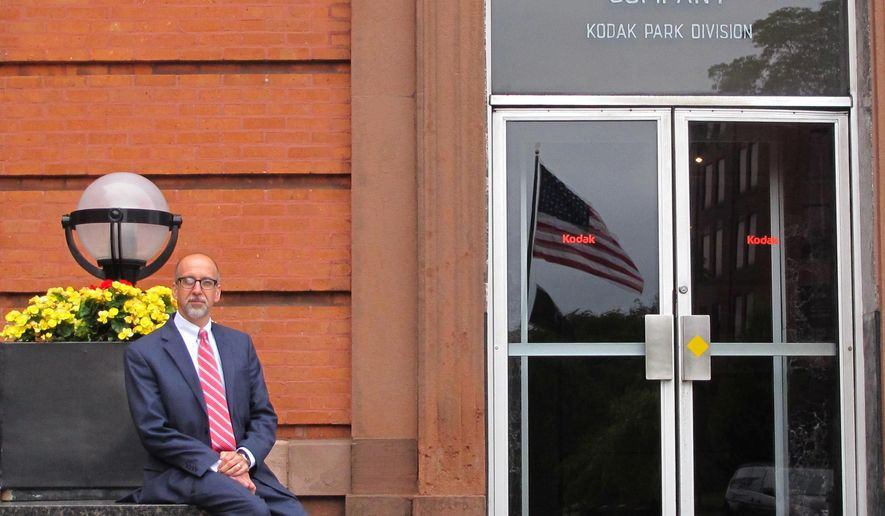 In this July 15, 2015 photo, Michael Alt, director of Eastman Business Park, sits outside the building in Rochester, N.Y., that housed Kodak founder George Eastman's office. Kodak considered selling its 1,250-acre business park to a smaller company after emerging from bankruptcy, but has instead been courting new businesses to the site, with the promise of access to plentiful utilities, infrastructure and Kodak's specialty technical and industrial capabilities. (AP Photo/Carolyn Thompson)