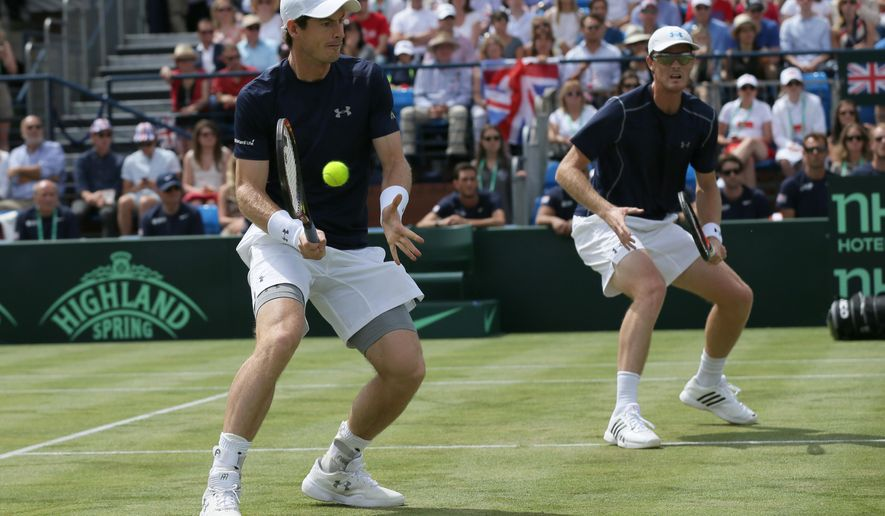 Britain's Andy Murray, left, and Jamie Murray during their doubles match against France's Jo-Wilfried Tsonga and Nicolas Mahut during the quarterfinal match of the Davis Cup at the Queen's Club in London, Saturday July 18, 2015. (AP Photo/Tim Ireland)