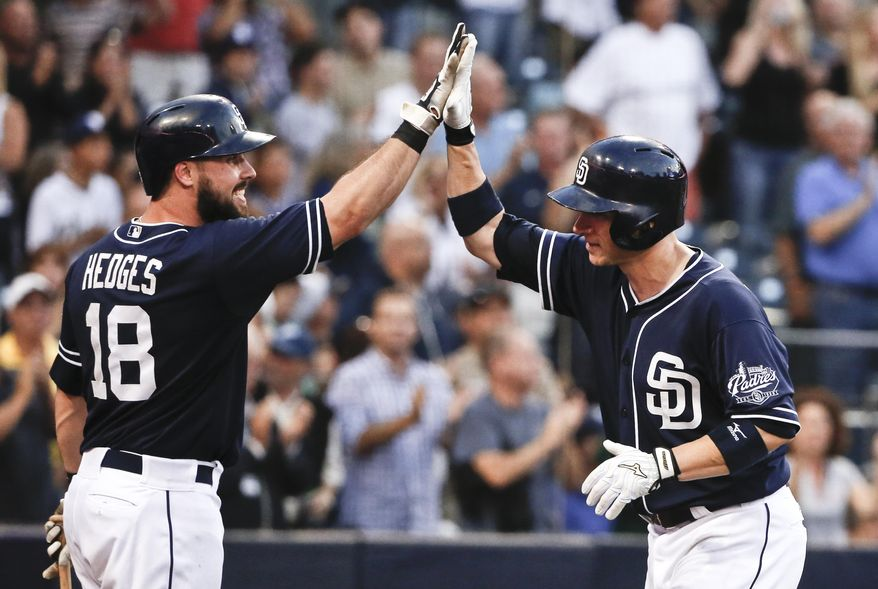 San Diego Padres' Clint Barmes, right, is congratulated by Austin Hedges after his two-run home run against the Colorado Rockies during the seventh inning of a baseball game Saturday, July 18, 2015, in San Diego. (AP Photo/Lenny Ignelzi)
