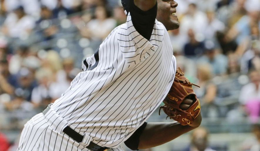 New York Yankees' Michael Pineda delivers a pitch during the first inning of a baseball game against the Seattle Mariners Saturday, July 18, 2015, in New York. (AP Photo/Frank Franklin II)