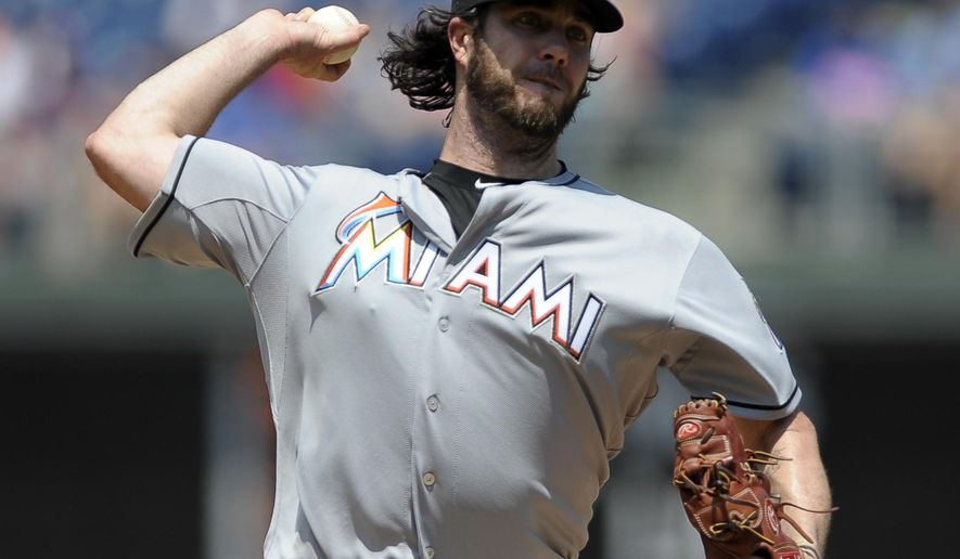 Miami Marlins starting pitcher Dan Haren throws in the first inning of a baseball game against the Philadelphia Phillies, Sunday, July 19, 2015, in Philadelphia. (AP Photo/Michael Perez)