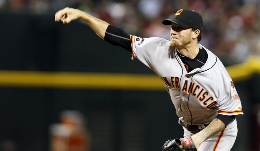 San Francisco Giants pitcher Jake Peavy throws in the first inning during a baseball game against the Arizona Diamondbacks, Saturday, July 18, 2015, in Phoenix. (AP Photo/Rick Scuteri)