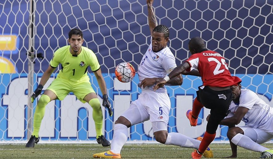 Panama's Roman Torres (5) deflects a shot by Trinidad & Tobago's Keron Cummings (20) as goalkeeper Jaime Penedo (1) watches during the second half of a CONCACAF Gold Cup soccer match Sunday, July 19, 2015, at MetLife stadium in East Rutherford, N.J. (AP Photo/Mel Evans)