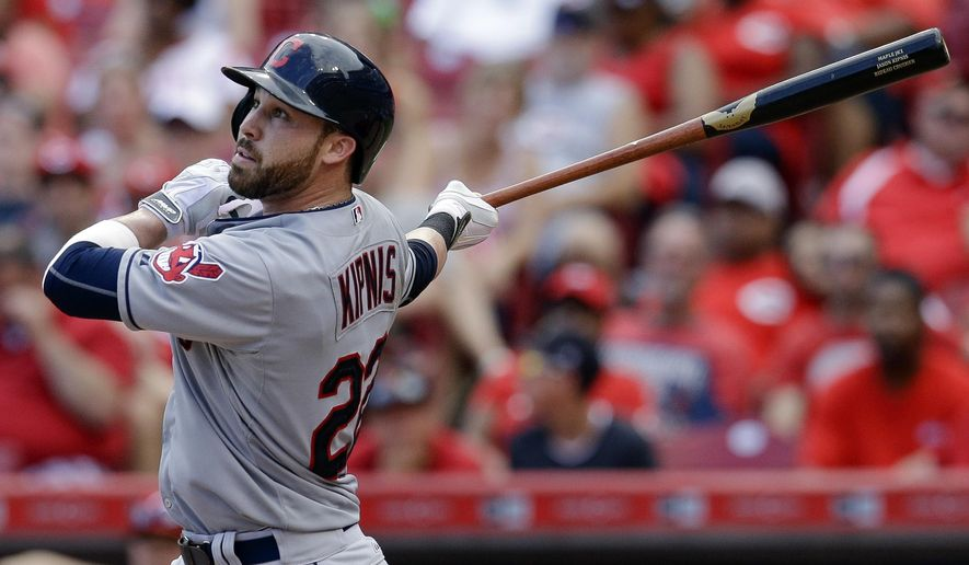 Cleveland Indians' Jason Kipnis hits a sacrifice fly off Cincinnati Reds relief pitcher Pedro Villarreal to drive in Michael Bourn in the eleventh inning of a baseball game, Sunday, July 19, 2015, in Cincinnati. The Indians won 5-3. (AP Photo/John Minchillo)
