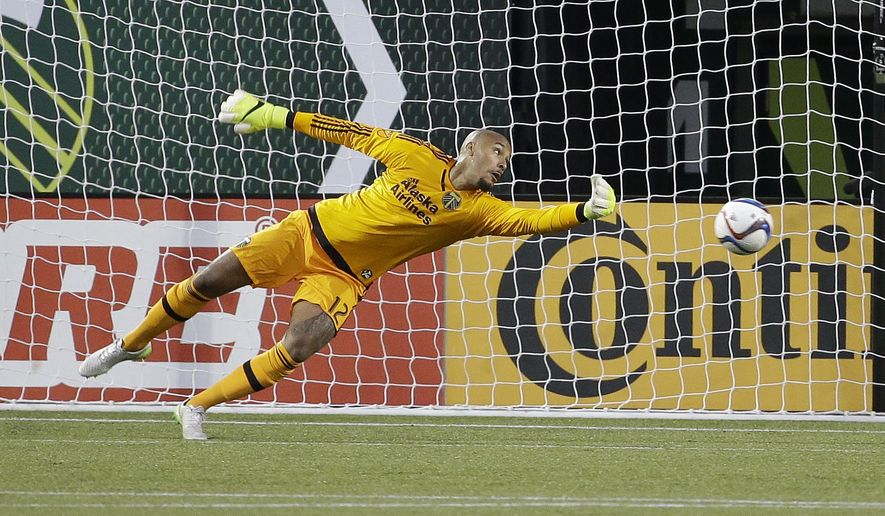 Portland Timbers goalkeeper Adam Kwarasey watches as the ball goes past his outstretched hand and into the net for a Vancouver Whitecaps goal during the second half of an MLS soccer game in Portland, Ore., Saturday, July 18, 2015.  Portland and Vancouver tied 1-1. (AP Photo/Don Ryan)