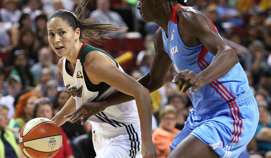 Atlanta Dream's Aneika Henry, right, closely guards Seattle Storm's Sue Bird during a WNBA basketball game in Seattle, Saturday, July 18, 2015. (Sy Bean/The Seattle Times via AP)