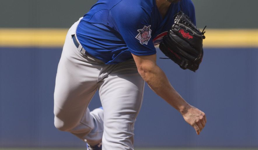 Chicago Cubs starting pitcher Jake Arrieta (49) works in the first inning of a baseball game against the Atlanta Braves, Sunday, July 19, 2015, in Atlanta. (AP Photo/John Bazemore)