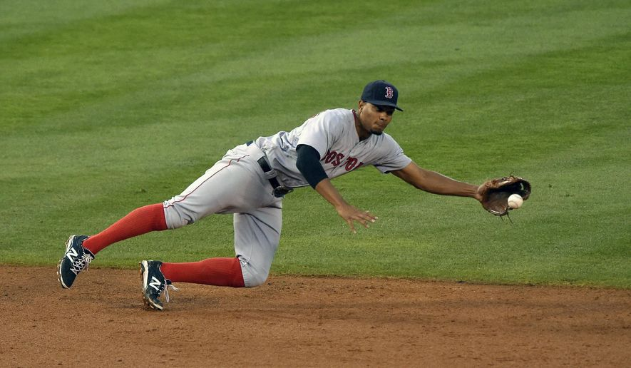 Boston Red Sox shortstop Xander Bogaerts can't reach a ball hit for a single by Los Angeles Angels' Albert Pujols during the third inning of a baseball game, Saturday, July 18, 2015, in Anaheim, Calif. (AP Photo/Mark J. Terrill)