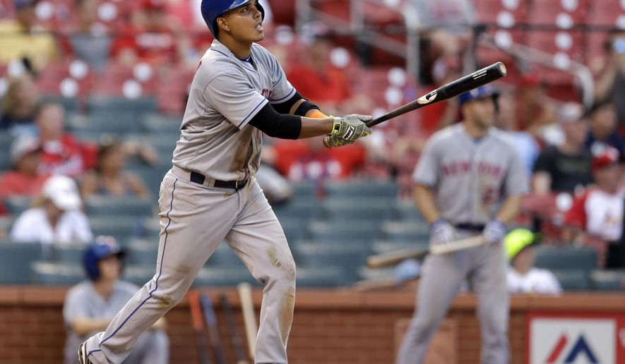 New York Mets' Ruben Tejada watches his sacrifice fly to score teammate Wilmer Flores during the 18th inning of a baseball game against the St. Louis Cardinals Sunday, July 19, 2015, in St. Louis. (AP Photo/Jeff Roberson)