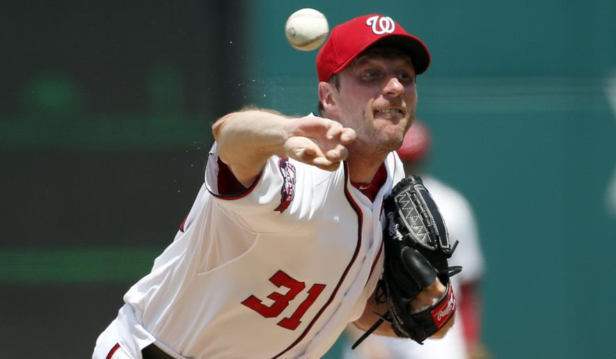 Washington Nationals starting pitcher Max Scherzer throws during the third inning of a baseball game against the Los Angeles Dodgers at Nationals Park, Sunday, July 19, 2015, in Washington. (AP Photo/Alex Brandon)