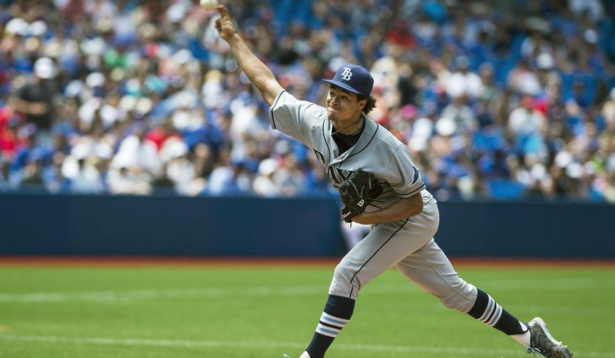 Tampa Bay Rays' pitcher Chris Archer works against the Toronto Blue Jays during the fifth inning of a baseball game in Toronto, Sunday, July 19, 2015. (Aaron Vincent Elkaim/The Canadian Press via AP) MANDATORY CREDIT