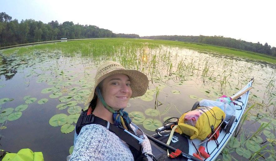In this July 2, 2015 photo, Alyssum Pohl, a Lexington native and University of Kentucky graduate, kayaks down the Mississippi River near Bemidji, Minn. Pohl, a 2004 biology grad and former Gaines Fellow, began her source-to-sea trip June 27 in Lake Itasca, Minn., and will take about three months to arrive at the Gulf of Mexico near New Orleans. (Alyssum Pohl via AP)
