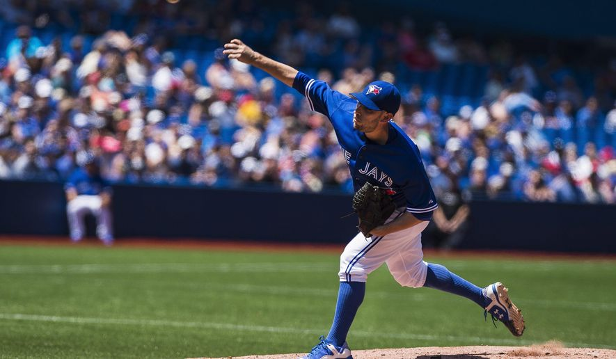 Toronto Blue Jays pitcher Marco Estrada works against the Tampa Bay Rays during second-inning baseball game action in Toronto, Sunday, July 19, 2015. (Aaron Vincent Elkaim/The Canadian Press via AP) MANDATORY CREDIT