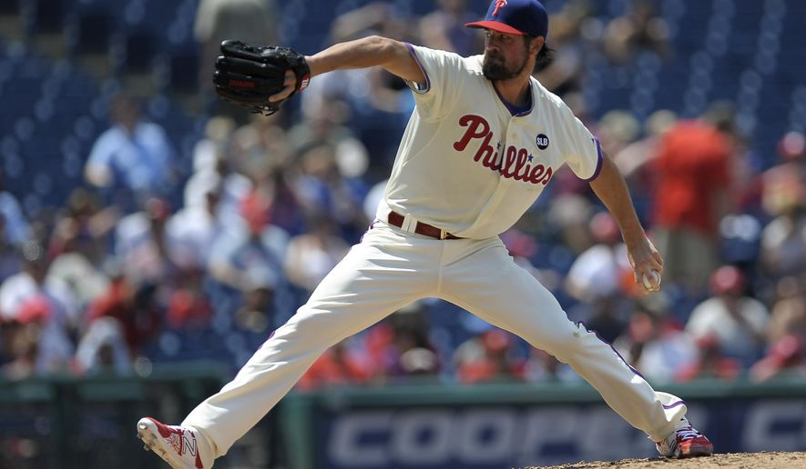 Philadelphia Phillies starting pitcher Cole Hamels throws in the third inning of a baseball game against the Miami Marlins, Sunday, July 19, 2015, in Philadelphia. (AP Photo/Michael Perez)