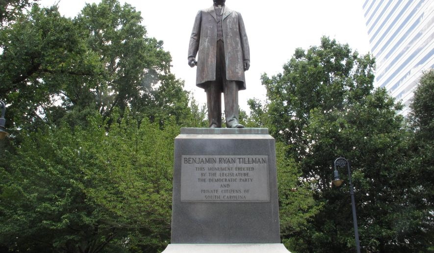 "The statue honoring former South Carolina governor and U.S. senator ""Pitchfork"" Ben Tillman is seen on the grounds of the Statehouse on Friday, July 17, 2015, in Columbia, S.C. Some civil rights leaders want the statue to also mention Tillman's violent segregationist views and role in the Hamburg Massacre where seven black Republicans were killed in 1876. (AP Photo/Jeffrey Collins)"