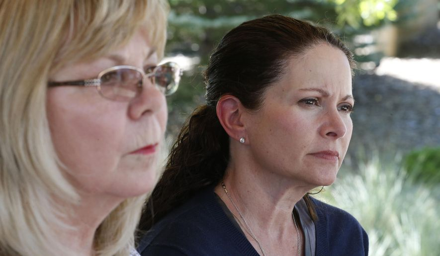 In this July 16, 2015 photo, Caren Teves, right, who lost her son Alex in the 2012 Aurora movie theatre massacre, sits with her friend Sandy Phillips, left, whose daughter Jessica Ghawi was killed in the attack, during an interview with The Associated Press, at a park near the Arapahoe County District Court, in Centennial, Colo. Phillips and Teves have become particularly close in the years since they suffered similar loses, sharing phone calls and text messages at moments they instinctually know will be difficult. With the Colorado theater shooter convicted of murder, survivors and relatives of the dead face an uncertain future after the trial comes to an end.  (AP Photo/Brennan Linsley)