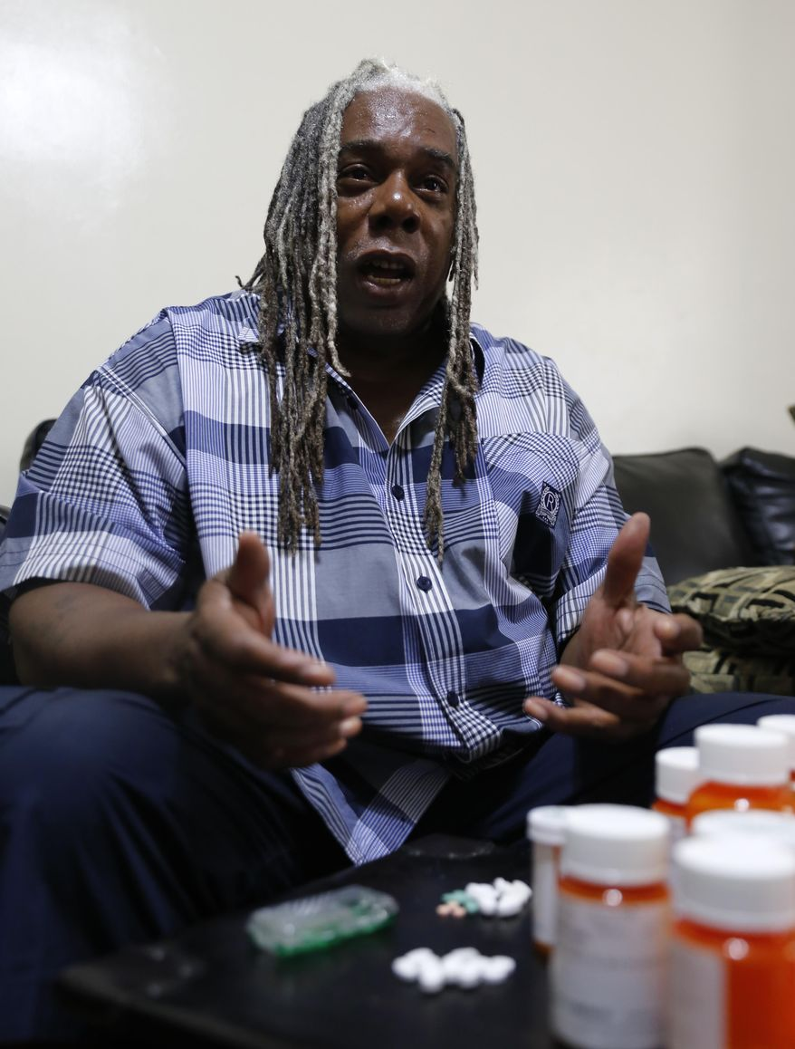 In this Monday, July 13, 2015 photo Earl Charles Williams Sr., 59, talks about the medication he must take for his diabetes in his Chicago home. Williams was uninsured for about a year before a county-run clinic helped him sign up for care under the Affordable Care Act. More than a dozen states that opted to expand Medicaid under the Affordable Care Act have seen enrollments surge way beyond projections, raising concerns that the added costs will strain their budgets when federal aid is scaled back starting in two years.  (AP Photo/Christian K. Lee)