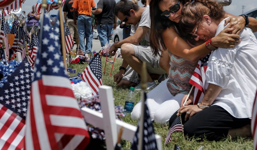 Mourners visited a makeshift memorial near the Armed Forces Career Center on Saturday for victims of the shootings in Chattanooga, Tennessee, on Thursday. President Obama's time in office has been peppered with terrorist-related attacks, raising complex questions about his handling of the fight against Islamist terror. (Associated Press)
