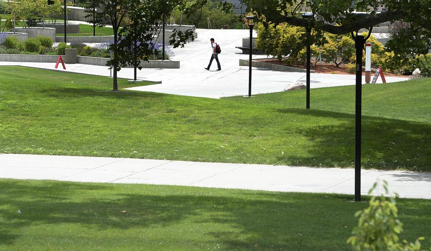 The area behind the University of Utah's Student Union has large, nicely-greened lawns inside a network of walking paths, Friday, July 10, 2015, in Salt Lake City. Despite efforts to conserve and xeriscape, the university has six zones that show up in the top 20 list of Salt Lake City water users. (Scott Sommerdorf/The Salt Lake Tribune via AP)