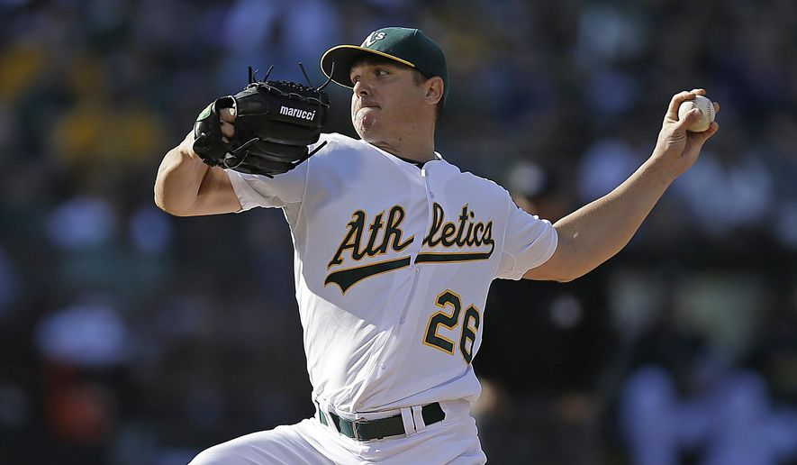Oakland Athletics pitcher Scott Kazmir works against the Minnesota Twins in the first inning of a baseball game Saturday, July 18, 2015, in Oakland, Calif. (AP Photo/Ben Margot)