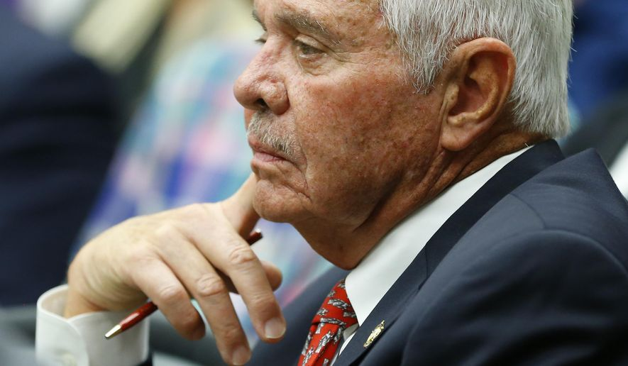 FILE - In this Monday, July 13, 2015 file photo, Tulsa County Sheriff Stanley Glanz listens to proceedings of a county commissioners meeting in Tulsa, Okla., Monday, July 13, 2015. A grand jury to investigate allegations of wrongdoing in the Tulsa County Sheriff's Office after a then-reserve deputy killed an unarmed man in April, is scheduled to meet on Monday, July 20, 2015. (AP Photo/Sue Ogrocki, File)