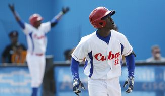 Cuba's Jose Garcia watches his ball while hitting a walk off home run off Puerto Rico pitcher Raul Rivera in the ninth inning of the bronze medal baseball game at the Pan Am Games, Sunday, July 19, 2015, in Ajax, Ontario. Cuba won 7-6. (AP Photo/Julio Cortez)