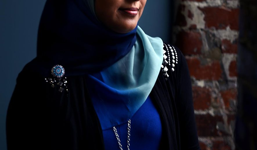 ADVANCED FOR RELEASE SUNDAY, JULY 19, 2015 Muslim activist Sabina Mohyuddin of Tullahoma, here July 1, 2015, has faced down dozens of angry anti-Muslim protestors in Middle Tennessee. (Shelley Mays / The Tennessean via AP)