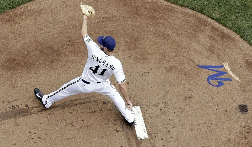 Milwaukee Brewers starting pitcher Taylor Jungmann throws during the first inning of a baseball game against the Pittsburgh Pirates Sunday, July 19, 2015, in Milwaukee. (AP Photo/Morry Gash)