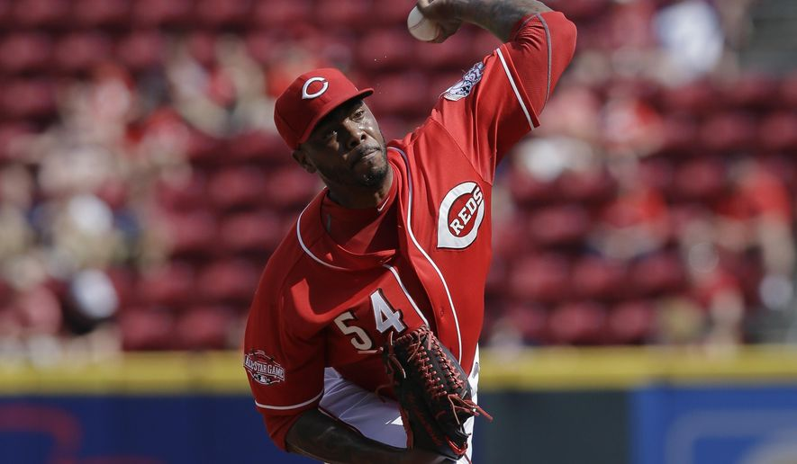 Cincinnati Reds relief pitcher Aroldis Chapman throws in the ninth inning of a baseball game against the Cleveland Indians, Sunday, July 19, 2015, in Cincinnati. Chapman struck out five in two innings to set a major league record for the fastest to reach 500 career strikeouts. (AP Photo/John Minchillo)
