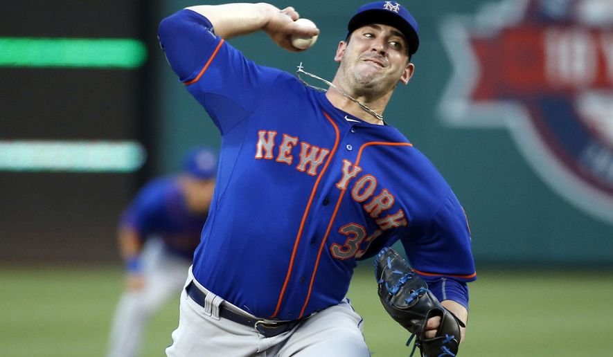 New York Mets pitcher Matt Harvey throws during the second inning of a baseball game against the Washington Nationals at Nationals Park, Monday, July 20, 2015, in Washington. (AP Photo/Alex Brandon)