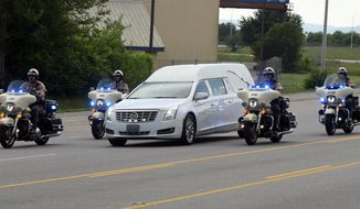 Members of the Tennessee Highway Patrol and the Chattanooga Police Department escort a hearse carrying the body of slain U.S. Navy Petty Officer Randall Smith on Amnicola Highway just past the U.S. Naval and Marine Reserve Center, Sunday, July 19, 2015, in Chattanooga, Tenn. Muhammad Youssef Abdulazeez attacked two military facilities, including the reserve center, last week in a shooting rampage that killed Smith and four Marines. (John Rawlston/Chattanooga Times Free Press via AP)