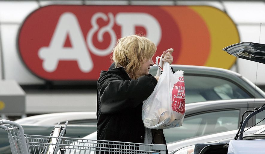 FILE - In this Monday, March 5, 2007, file photo, Jill Hatchman loads groceries into her car outside an A&P store, in Wall Township, N.J. The Great Atlantic & Pacific Tea Co., operator of A&P supermarkets, said Monday, July 20, 2015, that it is filing for Chapter 11 bankruptcy with plans to sell off stores as it faces increasingly tough competition. (AP Photo/Mel Evans, File)