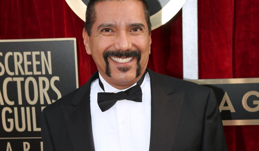 """Steven Michael Quezada an actor on the TV series """"Breaking Bad,"""" arrives at the 20th annual Screen Actors Guild Awards in Los Angeles. Mr. Quezada is jumping in a race for a heated county commissioner seat in Albuquerque. Mr. Quezada, who played DEA agent Steven Gomez in the hit AMC-TV series """"Breaking Bad&quot,"""" said Monday, July 20, he will announce this week that he will run for the Bernalillo County Commission. (Photo by Matt Sayles/Invision/AP, File)"""