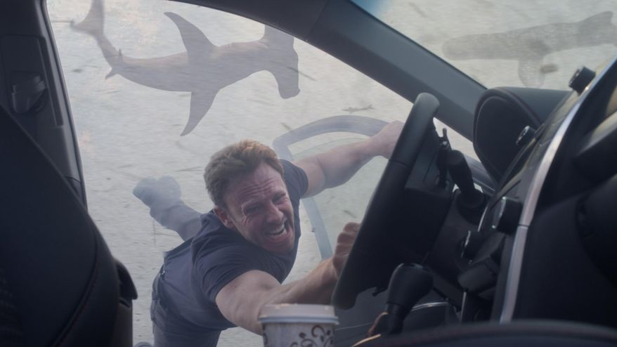"""Ian Ziering portrays Fin Shepard in """"Sharknado 3: Oh Hell No,"""" premiering Wednesday at 9 p.m. EDT on Syfy.  (Syfy via AP)"""