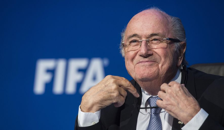 FIFA president Sepp  Blatter smiles  during a news  conference  at the FIFA headquarters in Zurich, Switzerland, Monday, July 20, 2015. During  an  extraordinary FIFA Executive Committee meeting the agenda for the elective Congress for the FIFA presidency was finalized and approved: The congress will take place on Feb. 26,  2016. (Ennio Leanza/Keystone via AP)