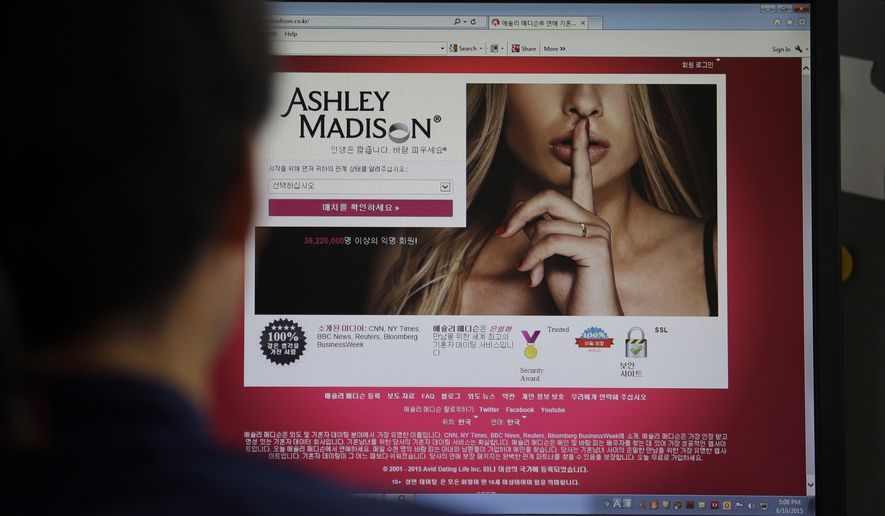 The Ashley Madison cheating website is shown on a computer screen in Seoul  on June 10