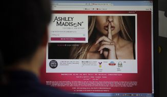 The Ashley Madison cheating website is shown on a computer screen in Seoul on June 10, 2015. (Associated Press) **FILE**