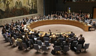 Members of the Security Council vote at United Nations headquarters, Monday, July 20, 2015. The U.N. Security Council unanimously endorsed the landmark nuclear deal between Iran and six world powers and adopted a series of measures leading to the end of U.N. sanctions that have hurt the Iranian economy. (AP Photo/Seth Wenig)