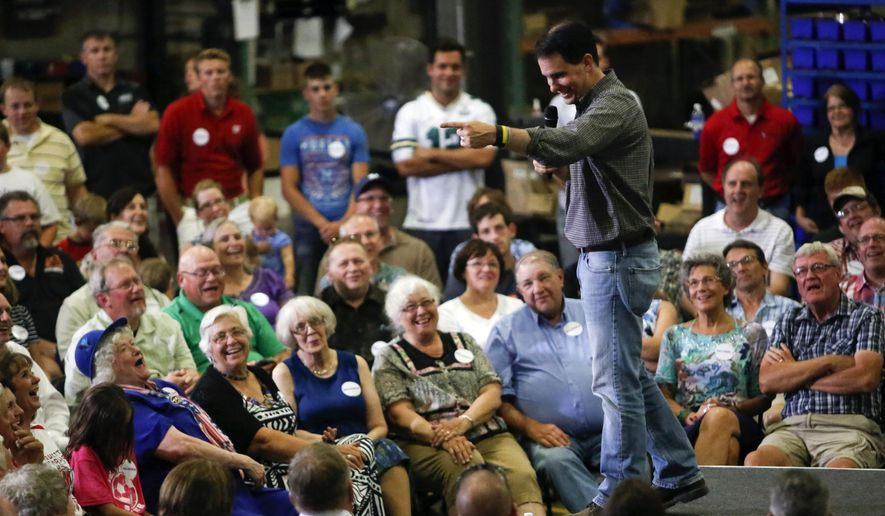 Republican presidential candidate Wisconsin Gov. Scott Walker addresses a crowd at Giese Manufacturing, Sunday, July 19, 2015, in Dubuque, Iowa. (Mike Burley/Telegraph Herald via AP)