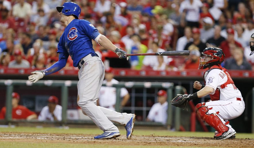 Chicago Cubs' Kris Bryant his a double off Cincinnati Reds' Michael Lorenzen (50) during the fifth inning of a baseball game, Monday, July 20, 2015, in Cincinnati. (AP Photo/Gary Landers)